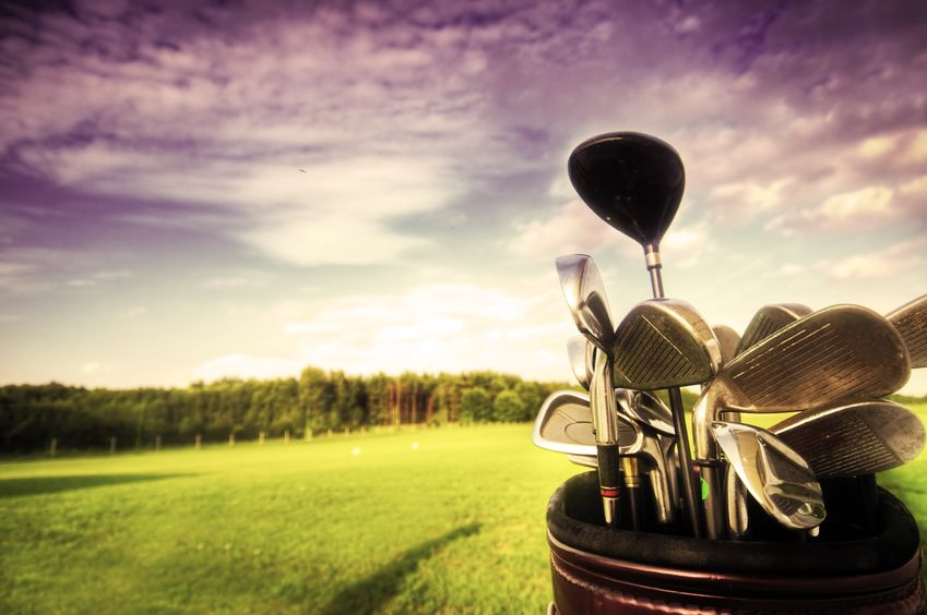 8579884 - professional golf gear on the golf field at sunset.